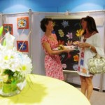 Ms. Marcia chats with Jodi and offers delicious canapes provided by Mise en Place
