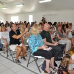 An audience of supportive families and friends