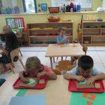 Building focus and fine motor skills in Casa.