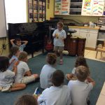 Singing an original song with a tambourine.