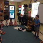 A child sings to an enrapt audience!
