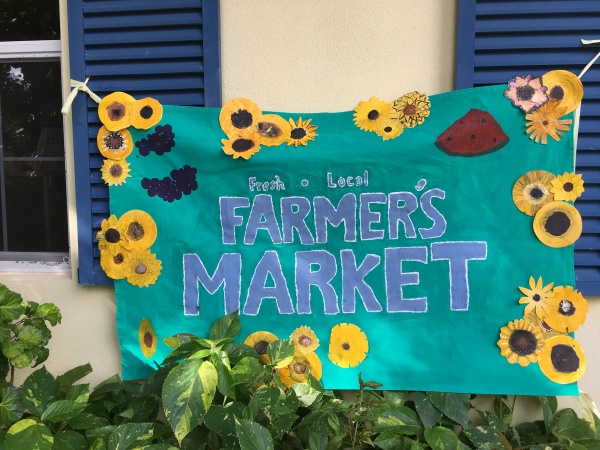 An Artistic Welcome: Upper El Students Create Market Banner