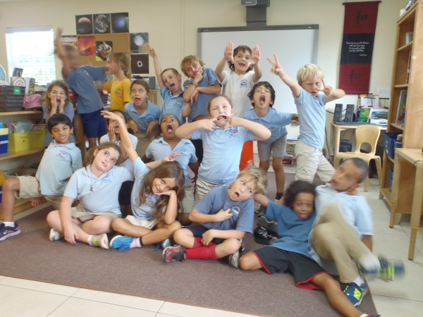 Students having a silly moment during a birthday celebration.
