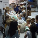 Filling bags with food at the Food Bank.