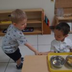 Toddlers learn to help each other.