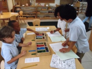 Getting right to work: Children independently building quantities and measuring on the first day of school.