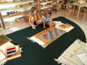 Two students work together on the checkerboard.