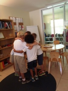 A group huddle during a brainstorming session for a charity lemonade stand.